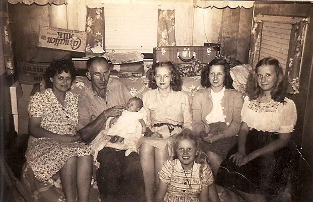 My Mom (kneeling on the floor) with her sisters, mother and step-dad.